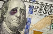 Bruised, Battered and Black Eyed Ben Franklin on the Newly Designed United States One Hundred Dollar