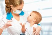 foto of pediatrics  - A doctor does injection child in hospital - JPG