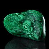 pic of malachite  - Polished malachite stone close up detail with reflection on black surface background - JPG