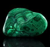 stock photo of malachite  - Polished malachite stone close up with reflection on black surface background - JPG