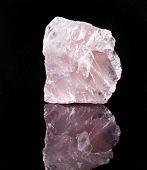 pic of rose-quartz  - Natural Rose Quartz crystal with reflection on black surface background - JPG