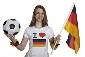 Attractive Woman Shows German Flag And Football And Smiles In Front Of White Background
