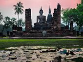 Buddha Statue and Ancient Ruins at Wat Mahathat, Sukhothai Province, Thailand