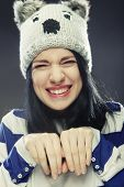 Playful young woman in funny winter hat