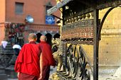 Buddhist Monks Spinning The Prayer Wheels