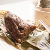 Unwrapped rice dumpling or zongzi. Traditional steamed sticky glutinous rice dumplings. Chinese food