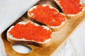 Red Caviar On A Slice Of Bread And Butter