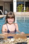 Smiling Girl Portrait In Pool