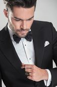 picture of tuxedo  - Close up picture of an elegant young man in tuxedo looking down - JPG