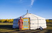 foto of mongolian  - Mongolian lady standing in front of the tent in scenic view - JPG