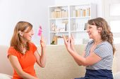 picture of deaf  - Smiling deaf woman learning sign language and talking with her teacher - JPG