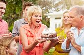 picture of multi-generation  - Multi Generation Family Celebrating Birthday In Garden - JPG