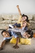 picture of pre-adolescent child  - Group of children playing on the living room floor - JPG