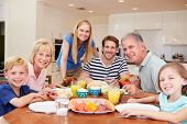 stock photo of multi-generation  - Multi Generation Family Enjoying Meal At Home Together - JPG