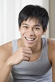 image of pacific islander ethnicity  - Young Pacific Islander man wearing tank top - JPG