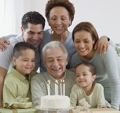 picture of extended family  - Senior Hispanic man celebrating birthday with family - JPG