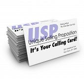stock photo of uniqueness  - Unique Selling Proposition USP words on a stack of business cards and the words It - JPG