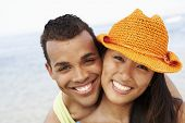 stock photo of heterosexual couple  - Couple hugging at beach - JPG