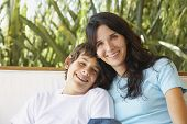 stock photo of pre-adolescent child  - Hispanic mother and son hugging - JPG