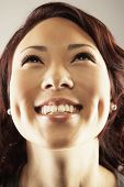 pic of dimples  - Asian woman looking up - JPG