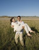 picture of pacific islander ethnicity  - Pacific Islander man carrying girlfriend - JPG