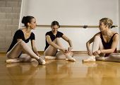 pic of leotards  - Hispanic female ballet dancers talking - JPG