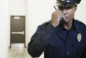 stock photo of apparel  - Security guard using a walkie - JPG