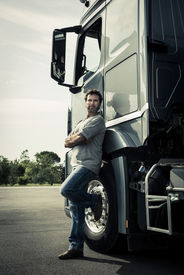 stock photo of truck-stop  - Portrait of a truck driver - JPG