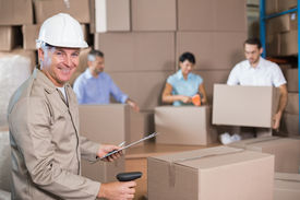 image of half-dressed  - Warehouse workers preparing a shipment in a large warehouse - JPG