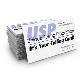 image of uniqueness  - Unique Selling Proposition USP words on a stack of business cards and the words It - JPG