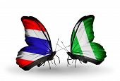 image of nigeria  - Two butterflies with flags on wings as symbol of relations Thailand and Nigeria - JPG