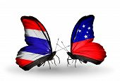 picture of samoa  - Two butterflies with flags on wings as symbol of relations Thailand and Samoa - JPG