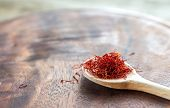 stock photo of saffron  - Saffron On The Wooden Spoon Close Up - JPG