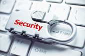 foto of cybercrime  - metal security lock with password on computer keyboard  - JPG