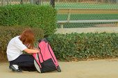 Schoolgirl with backpack poster
