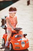 picture of car ride  - Cute little girl with chestnut colored hair and short hair - JPG