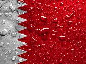 image of bahrain  - a flag of Bahrain with rain drops - JPG