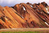 stock photo of hollow  - Smooth orange rhyolite mountains in Landmannalaugar nature reserve - JPG