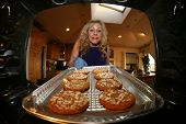 pic of wheat-free  - A sweet lady bakes up a batch of GLUTEN FREE Cookies - JPG