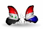 pic of holland flag  - Two butterflies with flags on wings as symbol of relations Syria and Holland - JPG