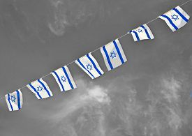 picture of israel people  - Israel flags in a chain in white and blue showing the Star of David hanging proudly for Israel - JPG