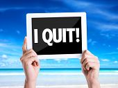 picture of quit  - Tablet pc with text I Quit with beach background - JPG