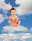 image of baby diapers  - Funny baby in diaper sitting on a cloud on the sky - JPG