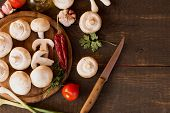 foto of champignons  - champignon mushrooms on a cutting board - JPG