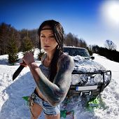 picture of muscle-car  - young athletic woman pulling car in winter - JPG
