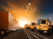 picture of railroad yard  - industry container trainst running on railways track plane cargo flying above and ship transport in import export container yard - JPG