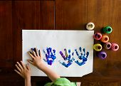 picture of finger-painting  - child finger painting with hands and making hand prints - JPG