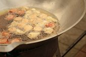pic of meatball  - Meatballs frying in a pan at the market - JPG