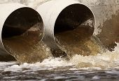 picture of water pollution  - Toxic water running from a sewer to the river - JPG