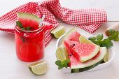 image of watermelon slices  - Healthy organic watermelon snack in a jar and  fresh watermelon slice in heart shape bowl - JPG